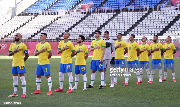 Players of Team Brazil stand for the national anthem prior to the Men's Football Semi-final match between Mexico and Brazil on day eleven of the...