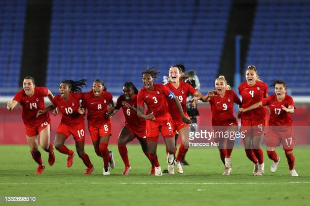 Players of Team Canada celebrate following their team's victory in the penalty shoot out in the Women's Gold Medal Match between Canada and Sweden on...