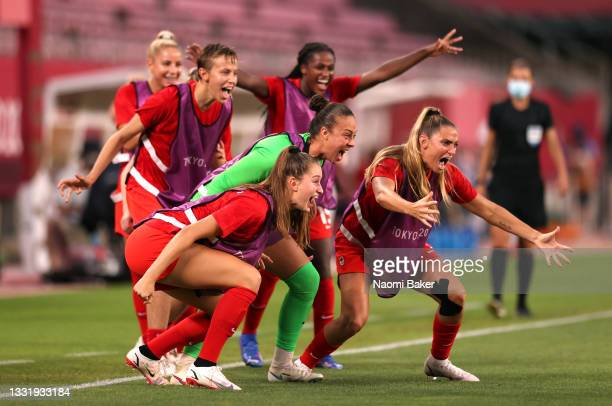 Players of Team Canada celebrate their side's first goal scored by Jessie Fleming of Team Canada during the Women's Semi-Final match between USA and...