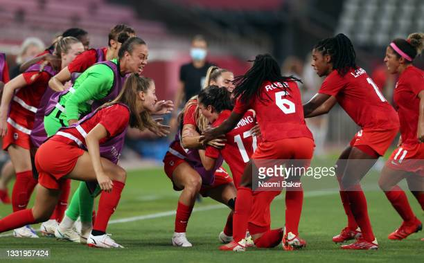 Players of Team Canada celebrate their side's first goal scored by Jessie Fleming of Team Canada during the Women's Football Semifinal match between...