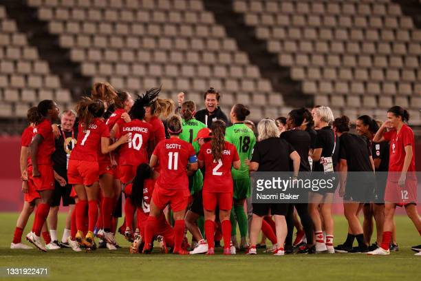 Players of Team Canada celebrate their side's victory after the Women's Semi-Final match between USA and Canada on day ten of the Tokyo Olympic Games...