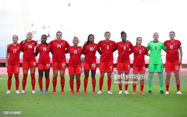 Players of Team Canada stand for the national anthem prior to the Women's Quarter Final match between Canada and Brazil on day seven of the Tokyo...