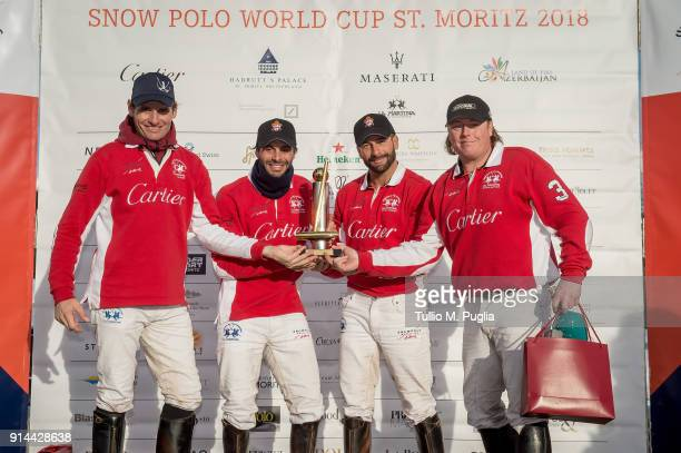 Players of Team Cartier Dario Musso Juan Cruz Greguoli Rommy Gianni and Chris Hyde attend award ceremony after winning the Snow Polo World Cup St...