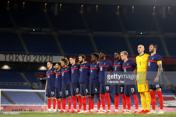 Players of Team France stand for the national anthem prior to the Men's Group A match between France and Japan on day five of the Tokyo 2020 Olympic...