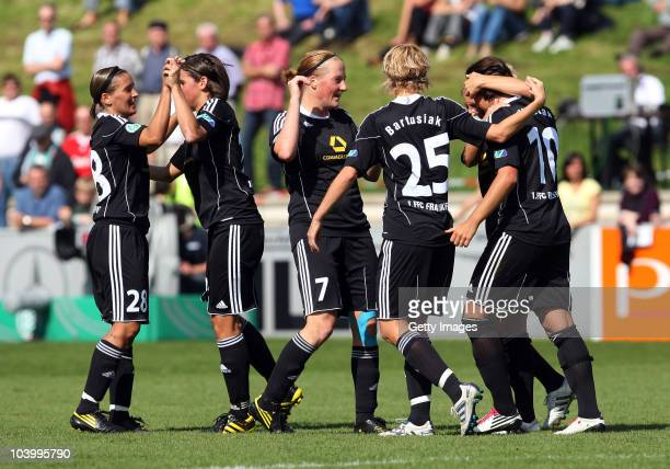 Players of team Frankfurt celebrate their first goal during the Women's bundesliga match between FCR Duisburg and FFC Frankfurt at the PCCStadium on...