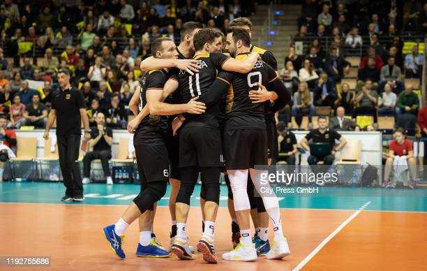 players of team Germany celebrate during the Volleyball European Qualification match between Bulgaria and Germany at MaxSchmelingHalle on January 9...