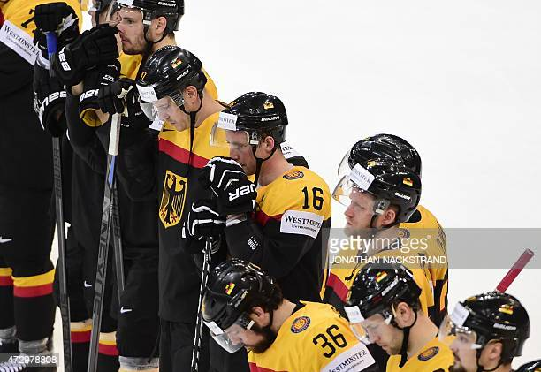 Players of team Germany react after loosing the group A preliminary round match Germany vs Austria at the 2015 IIHF Ice Hockey World Championships on...