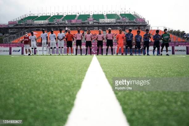 Players of Team Japan and Team France line up prior to the Football 5-a-side Preliminary Round Group A match on day 5 of the Tokyo 2020 Paralympic...