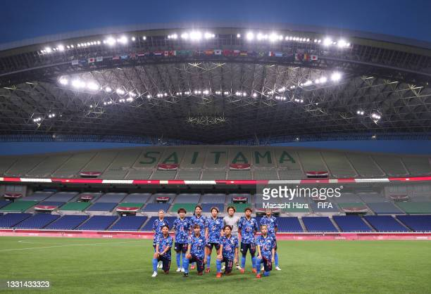 Players of Team Japan pose for a team photograph in front of empty seats prior to the Women's Quarter Final match between Sweden and Japan on day...