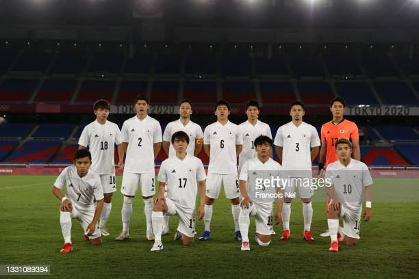 Players of Team Japan pose for a team photograph prior to the Men's Group A match between France and Japan on day five of the Tokyo 2020 Olympic...