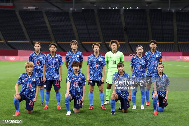 Players of Team Japan pose for a team photograph prior to the Women's First Round Group E match between Japan and Great Britain on day one of the...