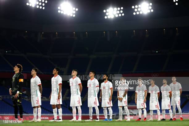 Players of Team Mexico stand for the national anthem prior to the Men's Quarter Final match between Republic Of Korea and Mexico on day eight of the...