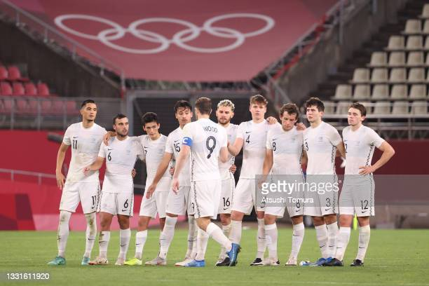 Players of Team New Zealand watch on during the penalty shoot out during the Men's Quarter Final match between Japan and New Zealand on day eight of...