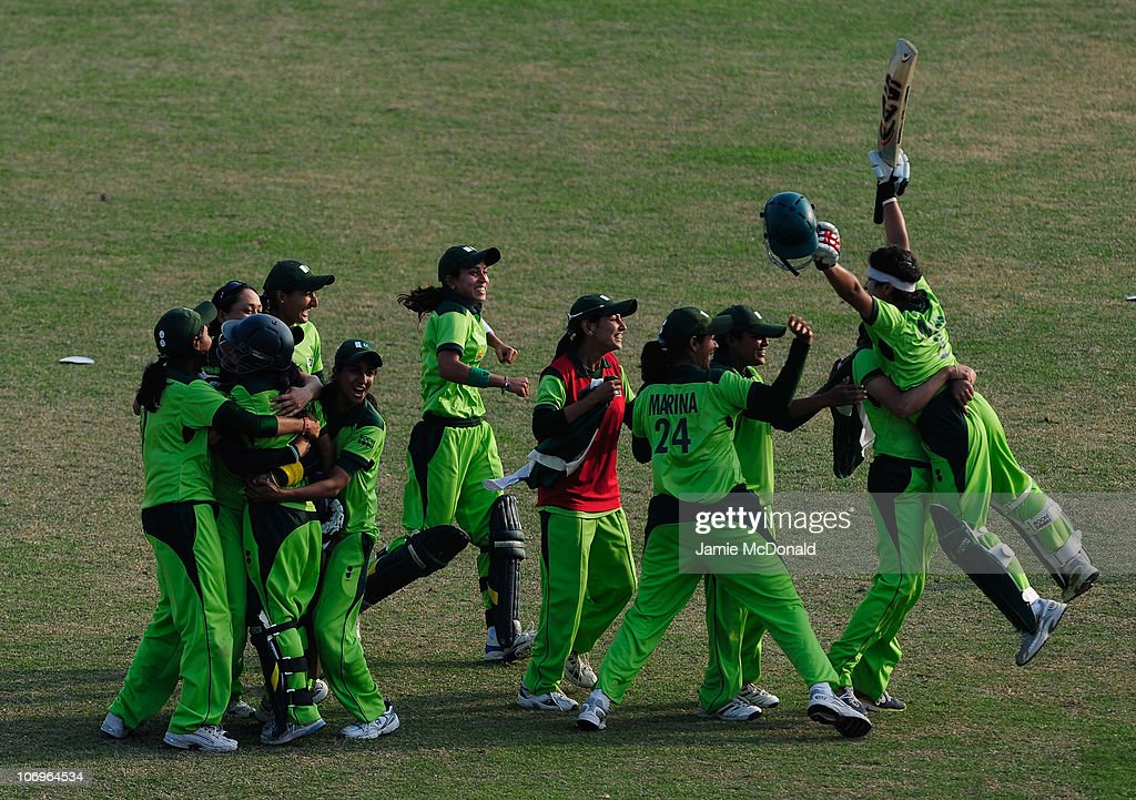 Players of team Pakistan celebrate winning Gold during the Woman's Gold Medal match between Pakistan and Bangladesh at Guanggong Cricket Stadium during day seven of the 16th Asian Games Guangzhou 2010 on November 19, 2010 in Guangzhou, China.