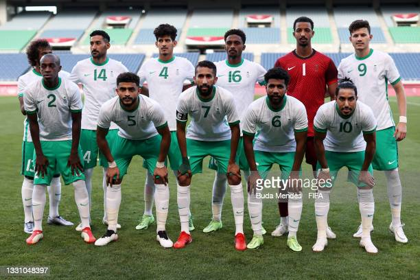 Players of Team Saudi Arabia pose for a team photograph prior to the Men's First Round Group D match between Saudi Arabia and Brazil on day five of...
