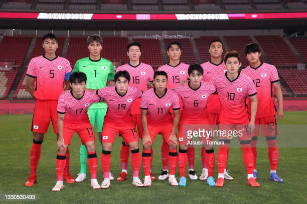 Players of Team South Korea pose for a team photograph prior to the Men's First Round Group B match between Romania and Republic of Korea on day two...