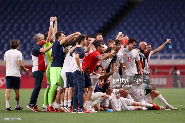 Players of Team Spain celebrate their side's victory after the Men's Football Semi-final match between Japan and Spain on day eleven of the Tokyo...