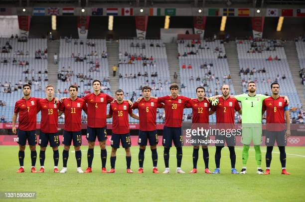 Players of Team Spain stand for the national anthem prior to the Men's Quarter Final match between Spain and Cote d'Ivoire on day eight of the Tokyo...