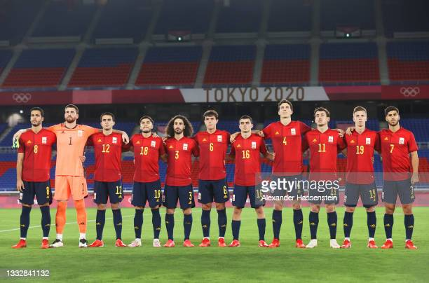 Players of Team Spain stand for the national anthem prior to the Men's Gold Medal Match between Brazil and Spain on day fifteen of the Tokyo 2020...