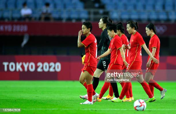 Players of Team Team China look dejected following defeat in the Women's First Round Group F match between China and Brazil during the Tokyo 2020...