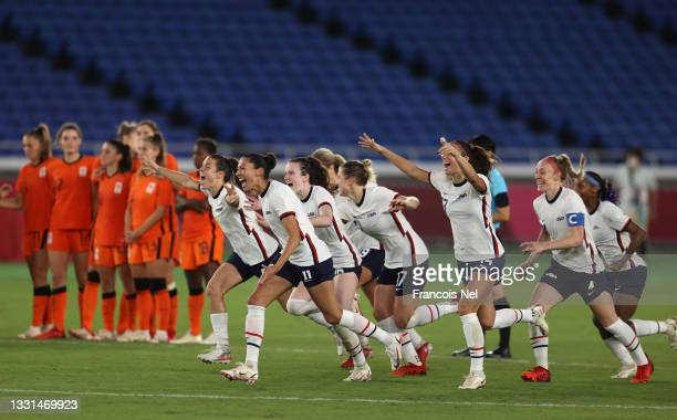 Players of Team United States celebrate following their team's victory in the penalty shoot out during the Women's Quarter Final match between...