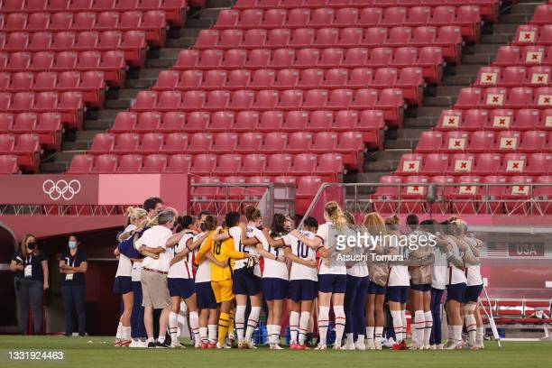 Players of Team United States form a huddle following defeat in the Women's Semi-Final match between USA and Canada on day ten of the Tokyo Olympic...