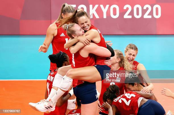 Players of Team United States react after defeating Team Brazil during the Women's Gold Medal Match on day sixteen of the Tokyo 2020 Olympic Games at...