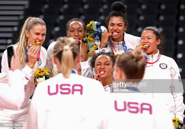 Players of Team United States react after receiving their Gold Medals during the Victory Ceremony following the Women's Gold Medal Volleyball match...