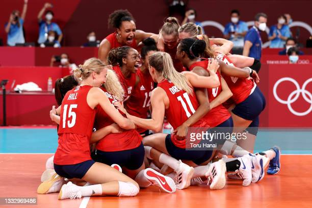 Players of Team United States react after they defeated Team Brazil during the Women's Gold Medal Match on day sixteen of the Tokyo 2020 Olympic...