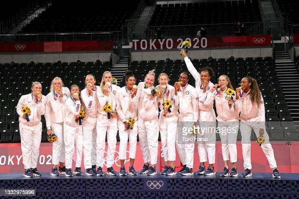 Players of Team United States react as they receive their Gold Medals during the Victory Ceremony following the Women's Gold Medal Volleyball match...