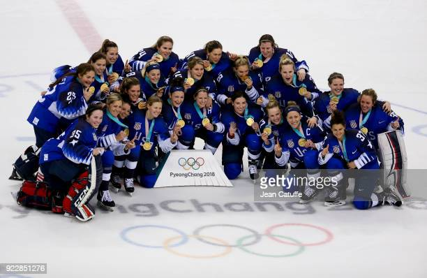 Players of Team USA celebrate winning the gold medal after penaltyshot shootout following the Women's Ice Hockey Gold Medal game final between USA...