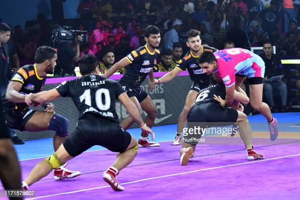 Players of Telgu Titans and Jaipur Pink Panthers in action during the Pro Kabaddi League match at SMS Indoor Stadium in JaipurRajasthan India Sept 27...
