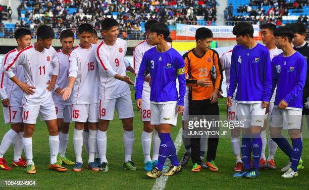 Players of the April 25 Sports Club of North Korea and the Gangwon-do team of South Korea prepare to pose for photos before their match during the...