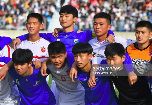 Players of the April 25 Sports Club of North Korea and the Gangwondo team of South Korea pose for photos before their match during the 5th Ari Sports...