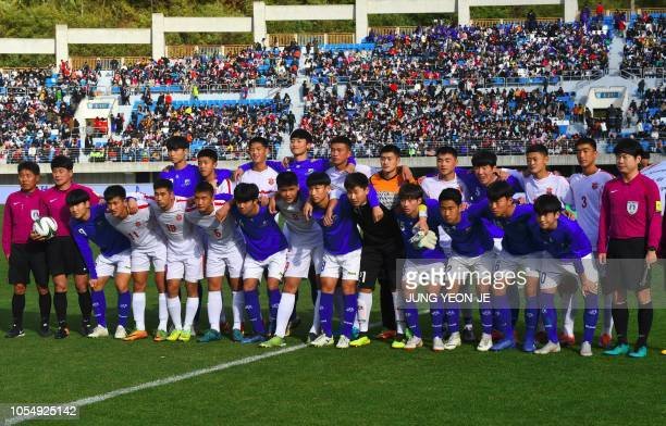 Players of the April 25 Sports Club of North Korea and the Gangwon-do team of South Korea pose for photos before their match during the 5th Ari...