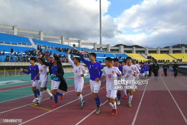 Players of the April 25 Sports Club of North Korea and the Gangwondo team of South Korea wave to their supporters after their match during the 5th...
