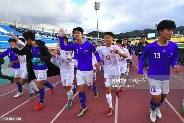 Players of the April 25 Sports Club of North Korea and the Gangwon-do team of South Korea wave to their supporters after their match during the 5th...