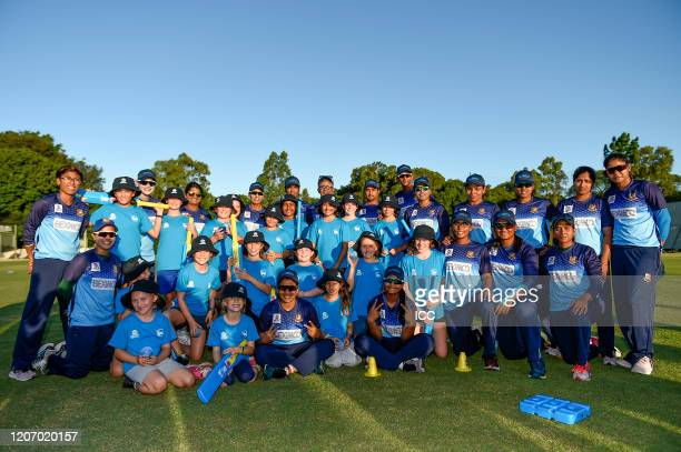 Players of the Bangladesh national women's team pose for photos with young fans during the ICC Women's T20 Cricket World Cup Cricket 4 Good Clinic at...