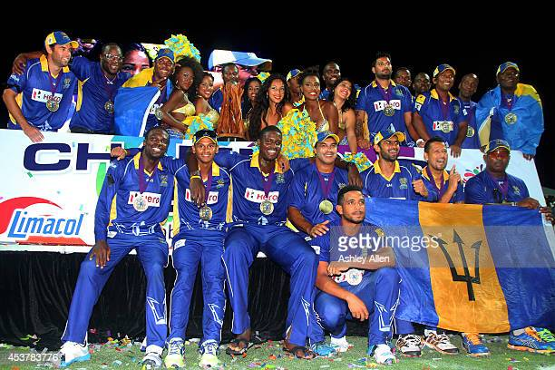 Players of the Barbados Tridents pose with the trophy after winning the Limacol Caribbean Premier League 2014 final match between Guyana Amazon...