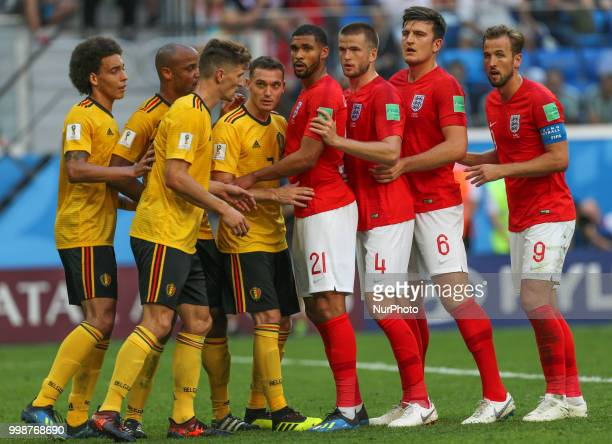 Players of the Belgium national football team and players of the England national football team vie for the ball during the 2018 FIFA World Cup...