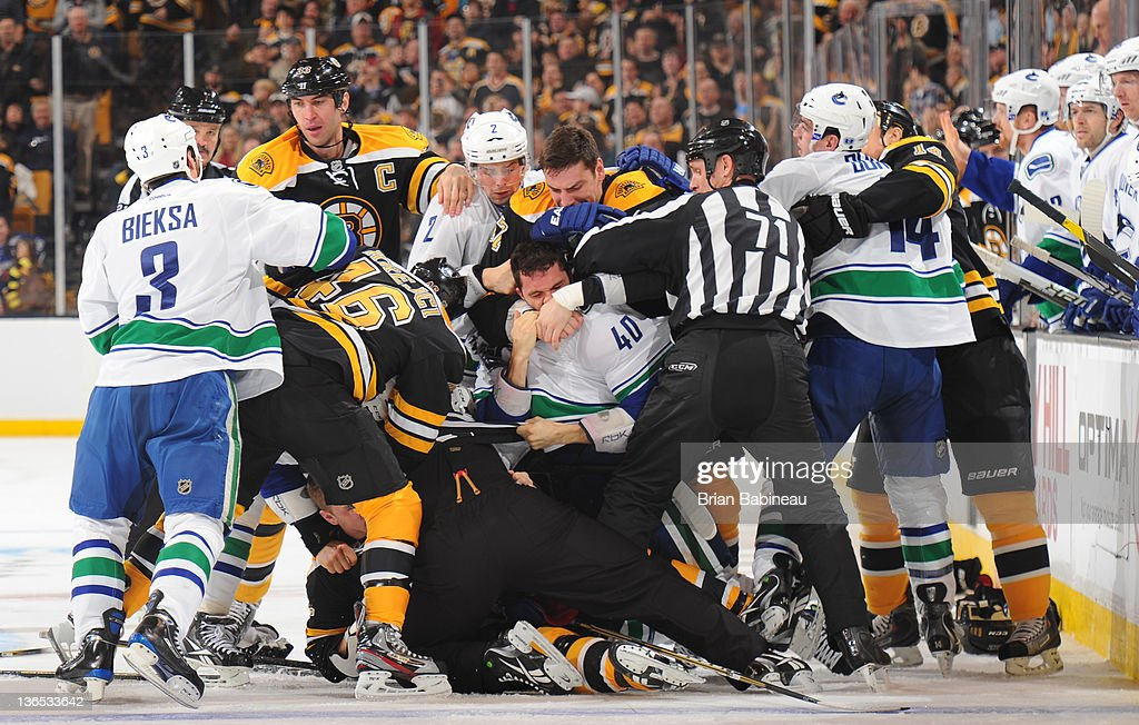 Players of the Boston Bruins fight with players the Vancouver Canucks at the TD Garden on January 7, 2012 in Boston, Massachusetts.