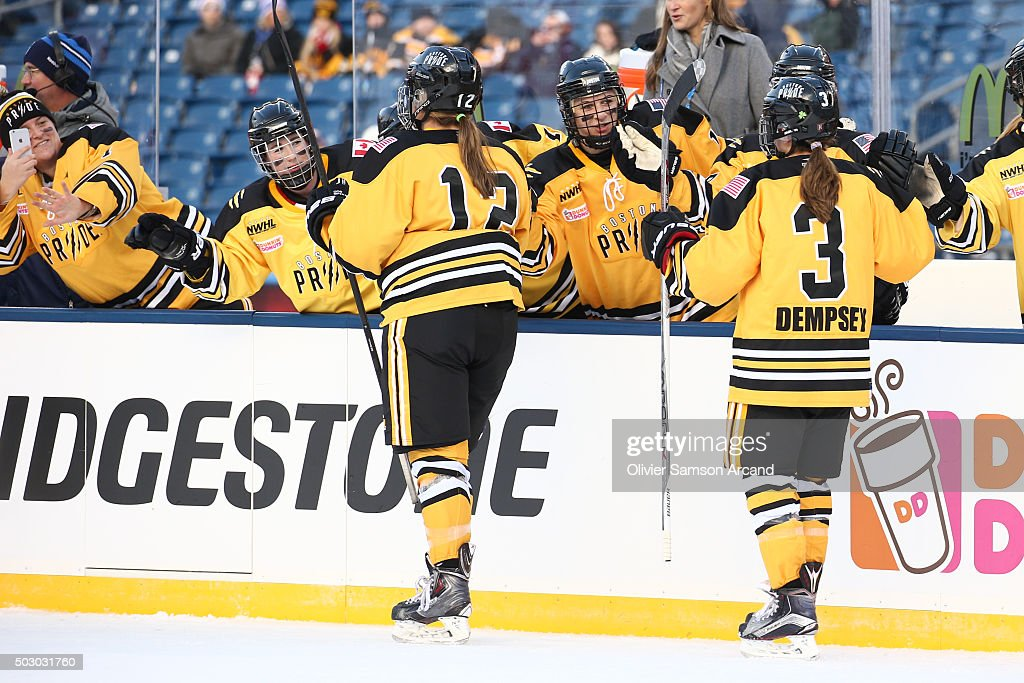Players of the Boston Pride celebrate a goal against the Les Canadiennes in the Women's Hockey Classic on December 31, 2015 during 2016 Bridgestone NHL Winter Classic at Gillette Stadium in Foxboro, Massachusetts.