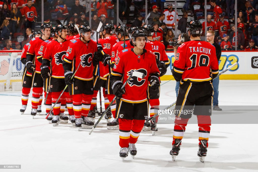 Players of the Calgary Flames after winning an NHL game against the St. Louis Blues at the Scotiabank Saddledome on November 13, 2017 in Calgary, Alberta, Canada.