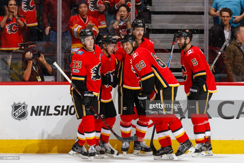Players of the Calgary Flames celebrate in an NHL game against the St. Louis Blues at the Scotiabank Saddledome on November 13, 2017 in Calgary, Alberta, Canada.