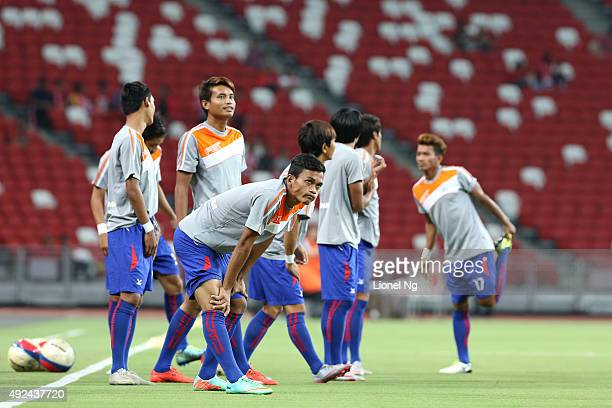 Players of the Cambodia national team warm up before the FIFA 2018 World Cup Qualifier match between Singapore and Cambodia at the National Stadium...