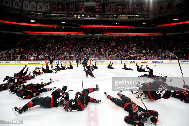 Players of the Carolina Hurricanes participate in their Storm Surge celebration following an NHL game against the Columbus Blue Jackets on January 4...