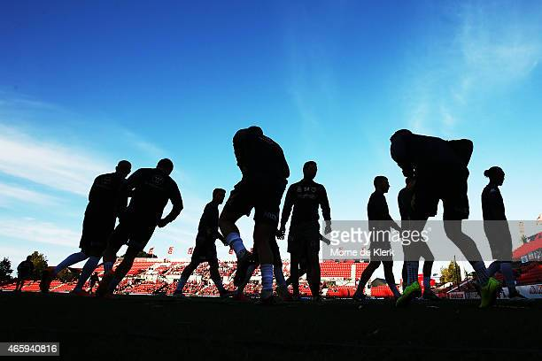 Players of the Central Coast Mariners warm up before the round 21 ALeague match between Adelaide United and the Central Coast Mariners at Coopers...