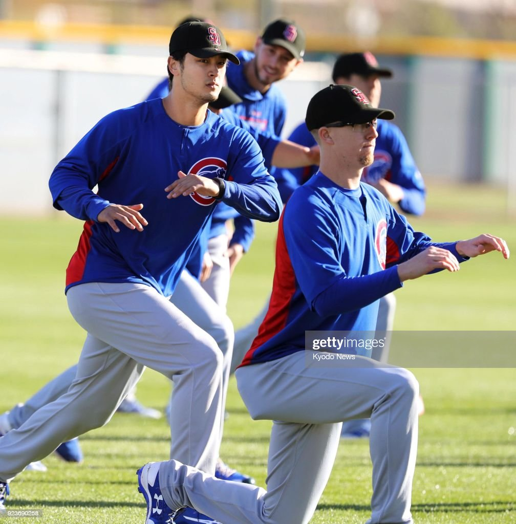 54baaf07e0262f Players of the Chicago Cubs work out in Mesa, Arizona on Feb. 23 ...