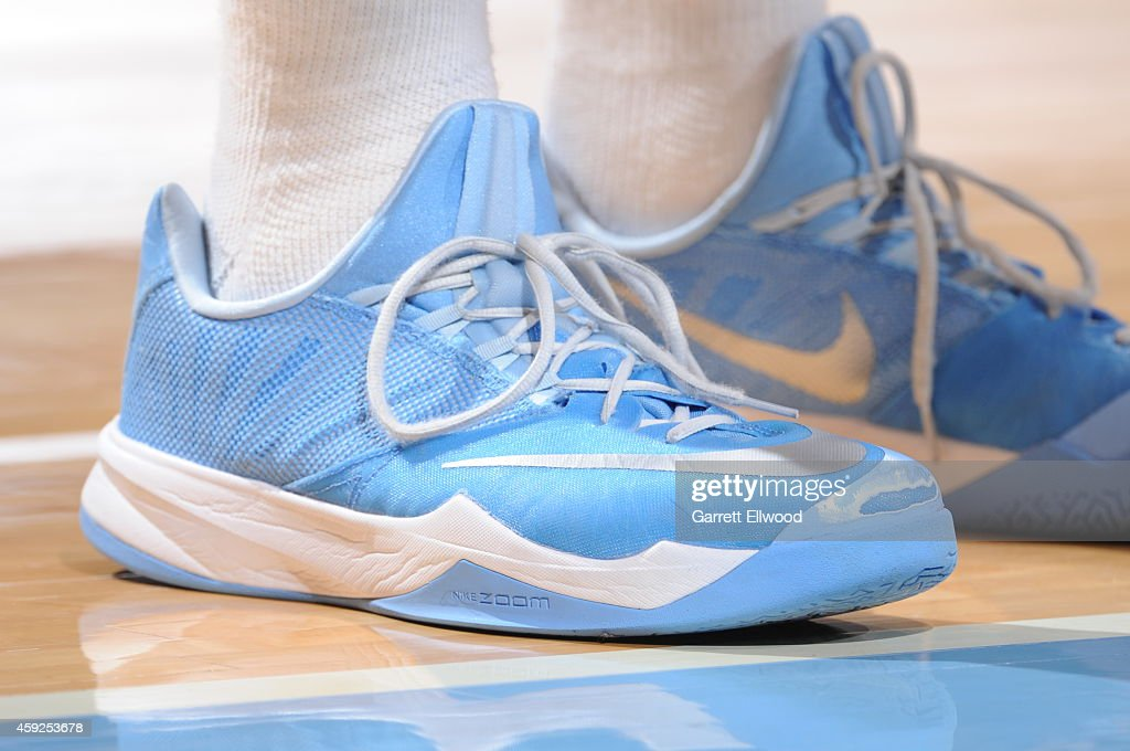 Players of the Denver Nuggets wear the new Nike Zoom shoes during a game against the Sacramento Kings on November 3, 2014 at the Pepsi Center in Denver, Colorado.