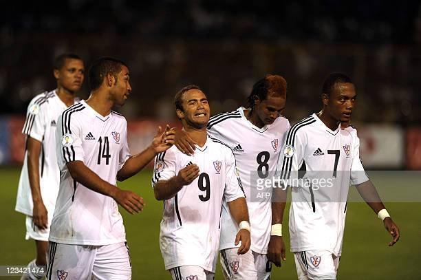 Players of the Dominican Republic National football team react at the end  of the first half 0dff12ccb